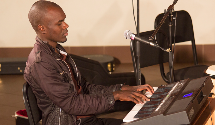 Student playing piano at the South East African Global Music Campus