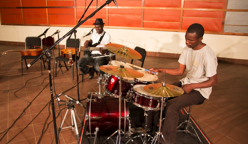 Student playing drums at Global Music Campus