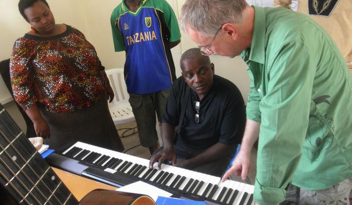 Playing piano at Global Music Campus