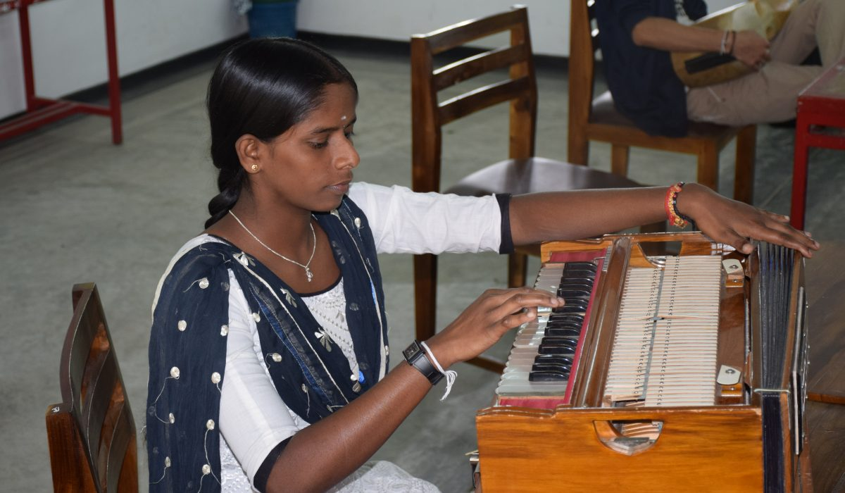 Playing a traditional instrument at Global Music Campus in Sri Lanka